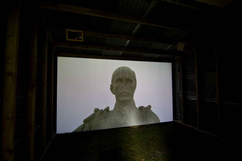 Harminder Judge > Bilocation 2013 ////// video installation, corrugated steel, timber, oil, pigment ////// dimensions variable